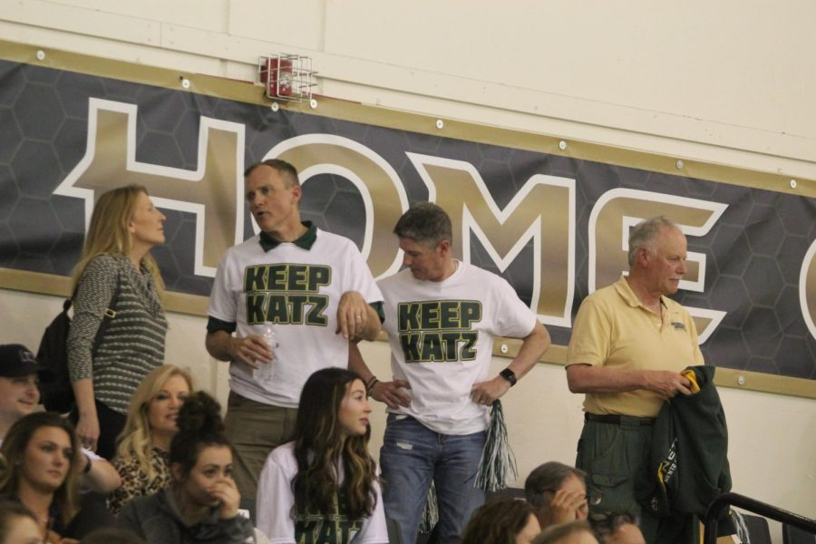 Two men in support of coach Brian Katz, wearing