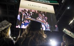 Graduating Sac State students watch themselves on a giant screen inside Golden 1 Center during the commencement procession May 18, 2018. Sac State administration is proposing a virtual commencement in addition to allowing spring 2020 graduates to walk at the spring 2021 commencement.