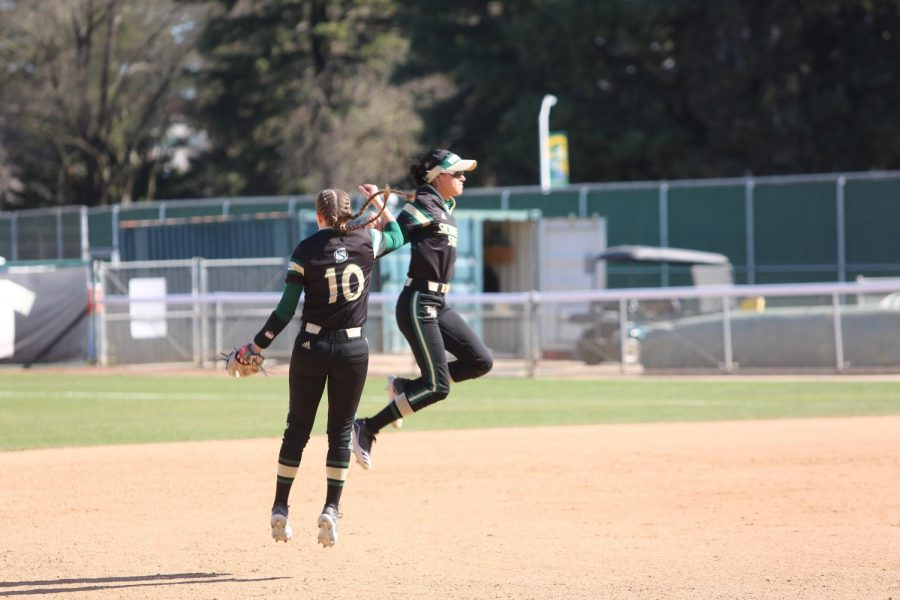 Sac State sophomore shortstop Shea Graves and freshman outfielder Aliyah Robles leap in celebration against UC Santa Barbara at Shea Stadium on Sunday, Feb. 9. Graves and the Hornets had their season canceled due to the COVID-19 pandemic.