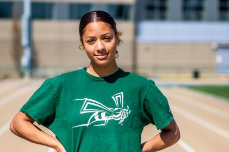 Sac State junior sprinter Mikayla Revera poses on the track at Hornet Stadium on March 10. Revera finished the indoor season with career bests in the 200 and 400 races.