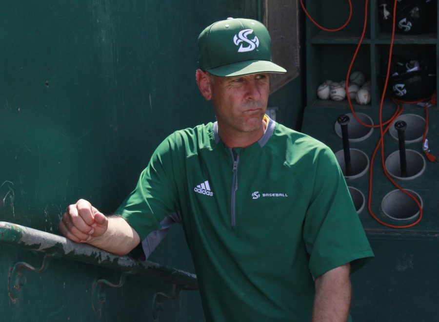 Sac State baseball coach Reggie Christiansen poses for a photo at John Smith Field. Christiansen has been relying on high school and travel ball coaches to get opinions on potential recruits.