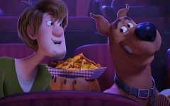 Shaggy Rogers (Will Forte) and Scooby-Doo (Frank Welker) share nachos at a movie theater during the latest addition to the Scooby-Doo franchise, SCOOB! (Photo courtesy of Warner Bros. Entertainment Inc.)