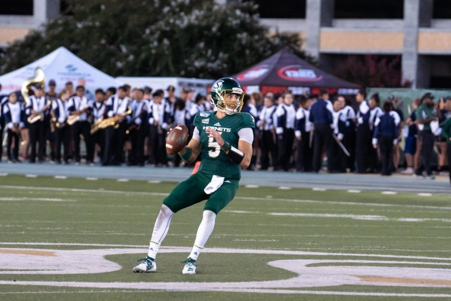 Sac State junior quarterback Kevin Thomson prepares to throw a pass against Northern Colorado on Sept. 14, 2019 at Hornet Stadium. Thomson had 361 passing yards, 53 rushing yards and five touchdowns in the 50-0 win.