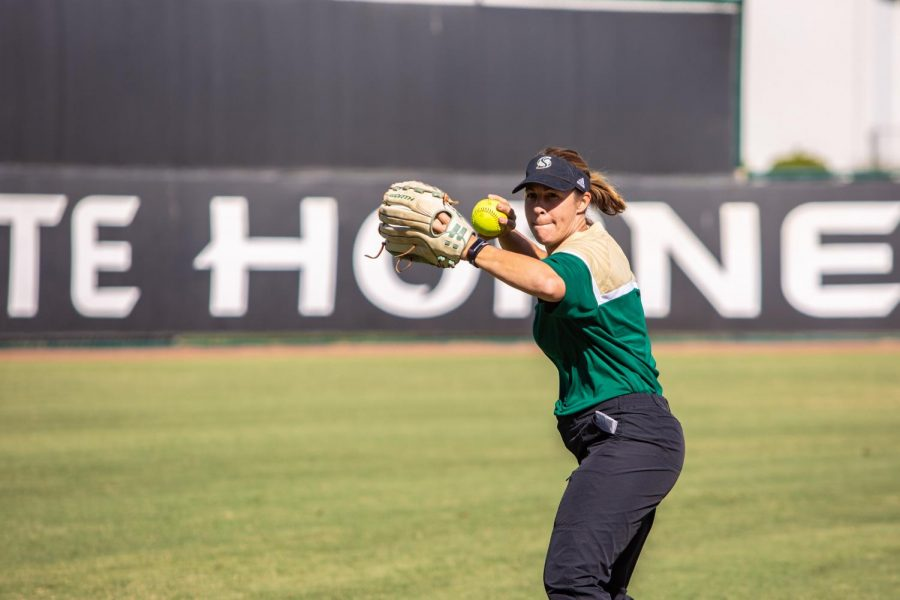 Sac State softball coach Lori Perez throws the ball during practice Wednesday, Oct. 9 at Shea Stadium. Perez said the cancellation of the season was a huge disappointment for her senior athletes.