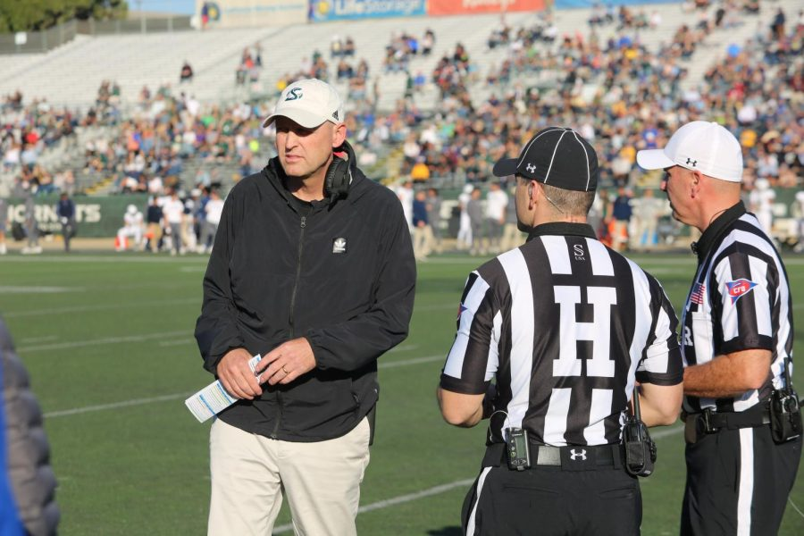 Sac State coach Troy Taylor chats with the officials during a match against UC Davis on Saturday, Nov. 23 at Hornet Stadium. Taylor said losing summer camps could be a tough situation since this is where his athletes have a chance to interact.