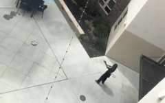 A man points a gun out of frame in a screenshot from a video of a shooting that took place at The Crossings Tuesday, July 21, 2020. The man was shot by the Sacramento police, and later transported to the hospital.