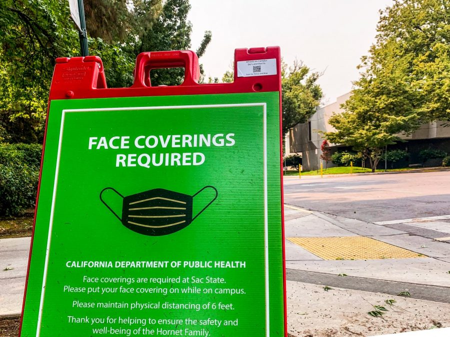 Sac State displays signs saying face coverings are required as the air quality worsens on campus Thursday, Aug. 20, 2020. The portable, foldable A frame signs are what the cyclists say they used to perform tricks in Guy West Plaza at Sacramento State on the night of June 4.