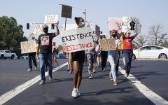 Protestors in Roseville, California march across the street during a Black Live Matter protest organized by Woodcreek High School students Saturday Sept. 5, 2020.
