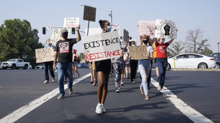 "Protestors in Roseville, California march across the street during a Black Live Matter protest organized by Woodcreek High School students Saturday Sept. 5, 2020. ""It's become clear that excessive police funding takes away funding from education, city enrichment and other services in low-income communities and in communities of color,"" said opinion writer Jordan Parker."