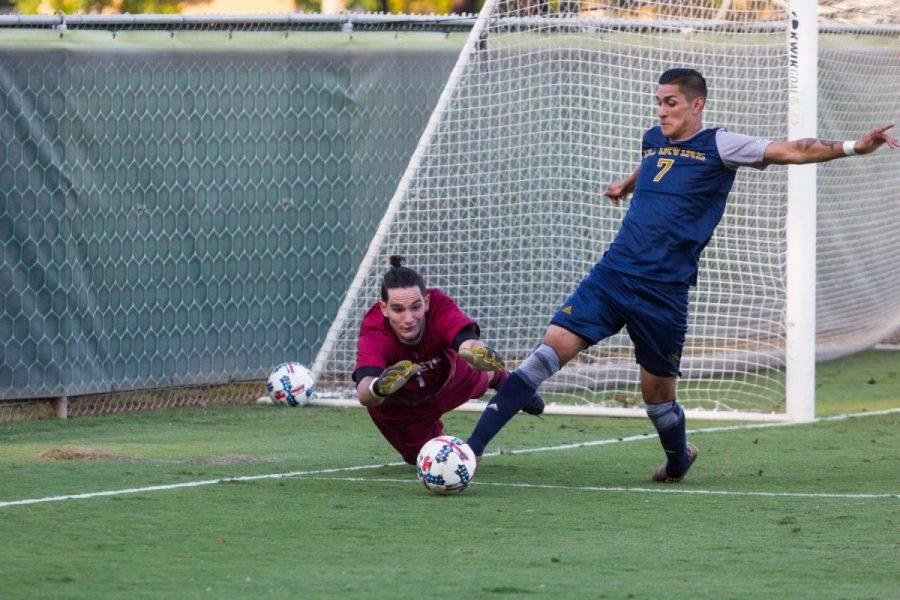 Sacramento State senior goalkeeper James Del Curto blocks a shot on goal by UC Irvine senior midfielder Giovanni Godoy Saturday, Sept. 30, 2017 at Hornet Field.