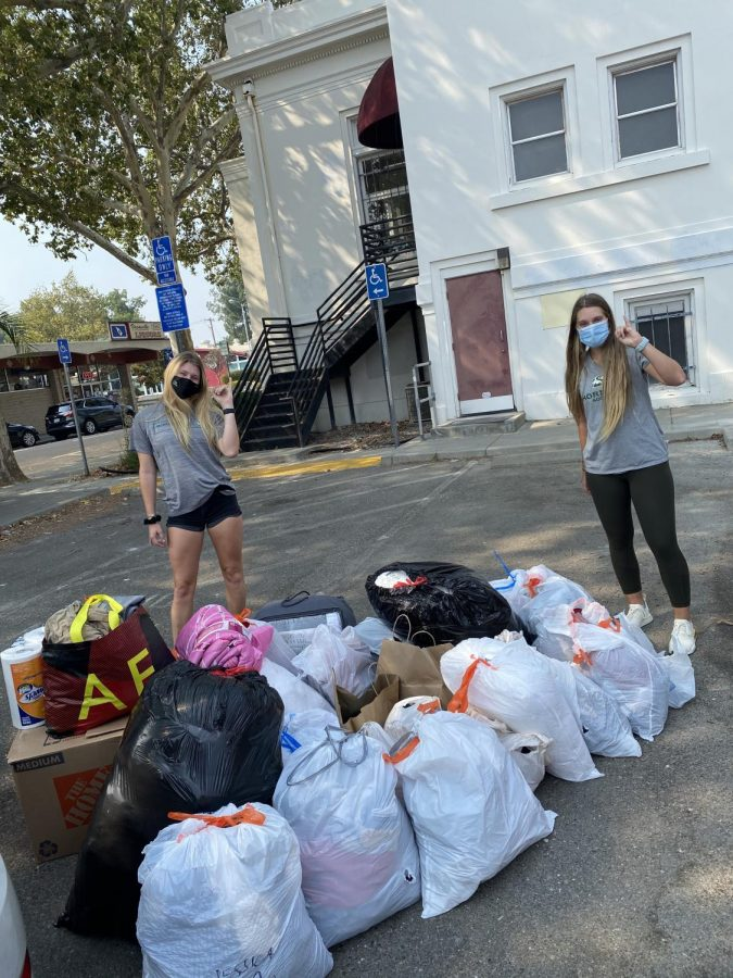 Sacramento State soccer players Shay Valenzano and Christina Lazar donating bags of clothes, shoes and toiletries on Thursday Aug. 27, 2020. The pair created a donation center for the Sac State women's soccer team to help those affected by the fires.