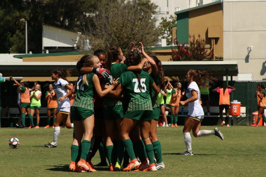 The Sac State women's soccer team celebrate the tying goal from junior forward Kylee Kim-Bustillos with about two minutes left in regulation against Cal Baptist on Sunday, Sept. 8, 2019 at Hornet Field. With the 2020 season on hold teammates Shay Valenzano and Christina Lazar organized a donation center for other members of the team to donate clothes, toiletries and shoes to the victims of California wildfires.