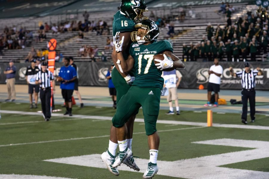 Sac State wide receiver Dewey Cotton, right, and tight end Marshel Martin, left, celebrate after Cotton scored a touchdown against Northern Colorado on Saturday, Sept.14, 2019 at Hornet Stadium. Cotton had a total of 14 yards receiving and one touchdown against the Bears.