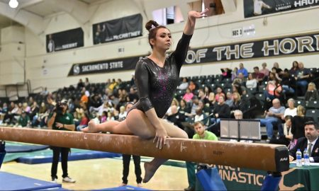 Sac State sophomore Amber Koeth poses on the balance beam during a meet last year at the Nest. Koeth spoke with The State Hornet about her battle with depression. Photo courtesy of Sac State Athletics.