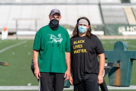 Kris (left) and Kaden (right) Richardson pose at Hornet Stadium after football practice on Thursday, Sept. 17th. Masks have been made mandatory for athletes and staff on the field.