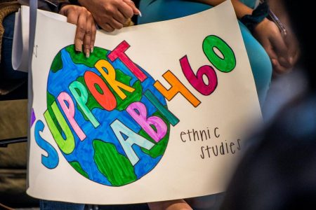 A demonstrator holds a sign advocating for AB 1460 in the University Union at a Faculty Senate meeting Thursday, Feb. 27, 2020. Sacramento State
