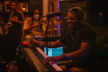BAOBAB pianist Kenan Jackson plays the keyboard at the Sacramento apartment-turned-studio, Taylor