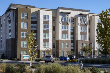A car pulls into The Crossings apartment complex on Ramona Avenue in Sacramento, California, Monday, Oct. 26, 2020. Sacramento PD were notified of a bomb threat against The Crossings at 1:40 p.m., and nothing was found, according to Officer Karl Chan.
