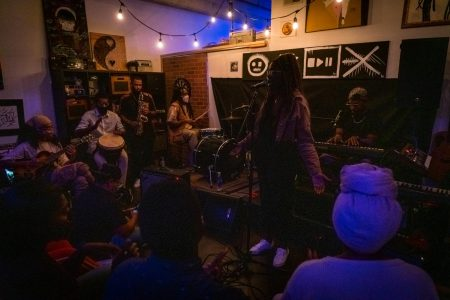 Greo the Storyteller, along with local band BAOBAB, perform for over a dozen people at Taylor