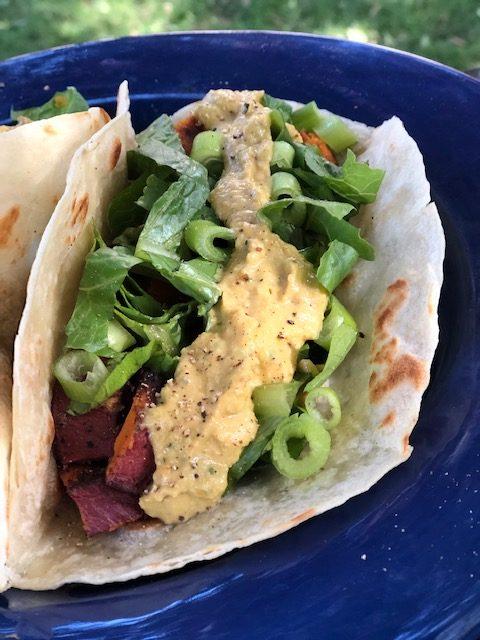 Sweet potato taco, romaine, scallions, spicy roasted persimmon and avocado salsa.