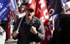 A Trump supporter clashes with other members of his group where were all protesting the election results in Sacramento, California, Saturday Nov. 21, 2020. The argument was over the police action taken against the marchers at Cesar Chavez Plaza.