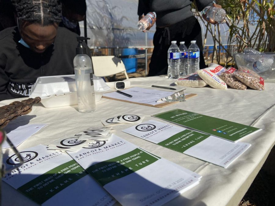 Sankofa Market offered pamphlets and stickers to help spread awareness of the community market in Sacramento on Sunday, Nov. 15, 2020. The market was established to help the lower-income areas of Sacramento and provide affordable fresh food for the community.