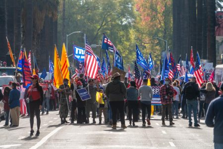 Trump supporters gather on Saturday, Nov. 14th, 2020 along 10th Street in front of the California State Capitol in response to Joe Biden's projected election victory. South Korean flags could be seen alongside