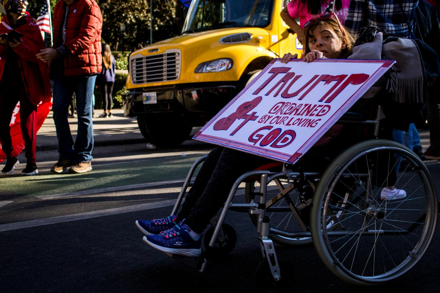 "Britten Scholtz, 35, who is disabled and mute, arrives at the rally to show support for President Donald Trump at the ""Stop the Steal"" protest at the California State Capitol on Saturday, Nov. 7, 2020. Scholtz, with her parents, has showed strong religious support for Trump during his term as president."