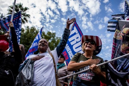 Chantay Ross (left) and other protestors sing to the closing lyrics of the United States national anthem at the California State Capitol on Saturday, Nov. 7, 2020, for a Trump rally calling for recounting votes in California and in battleground states. Ross states her cause for a recount due to not trusting the voting process. (Rahul Lal)