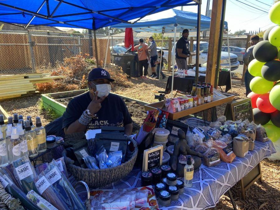 Cleo Cartel, owner of Momma's Market, sells her specialty goods from all over the world at the Sankofa Market in Sacramento on Sunday, Nov. 15, 2020. Cartel mainly caters her products to people of color and said she understands and values this market because it gives entrepreneurs an opportunity to profile and sell their products.