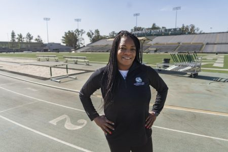 Sac State track and field assistant coach Kimberly Graham-Miller poses at the Hornet Stadium Monday, Oct. 26. Graham-Miller discussed the importance of female empowerment and support in athletics.