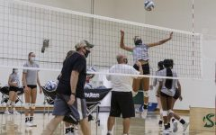 Senior outside hitter Macey Hayden spikes the ball over the net during the Sac State volleyball team practice at Yosemite Hall at Sacramento State Wednesday, Oct. 21, 2020. All participants are required to wear a mask while at practice.