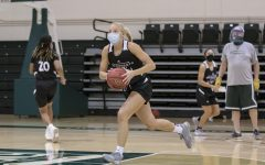 Summer Menke runs through a play and passes the ball to the wing during the women's basketball team practice at The Nest at Sacramento State Oct. 27, 2020. Student athletes will be required to get tested for COVID-19 three times a week once their seasons begin.