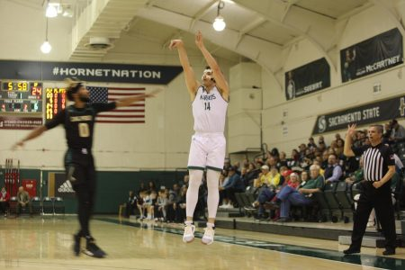 Sac State junior guard William FitzPatrick shoots a 3-pointer against Cal Poly on Wednesday, Dec. 18 at the Nest. FitzPatrick transferred from Folsom Lake JC and is one of five local players on the team.