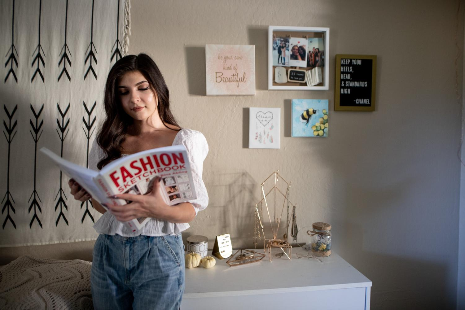 Quarantine has given Jaime Jolicouer more time to add decorations to her space that represent who she is. A little bee painting she did a few months ago hangs on display to show her creative side and a letterboard with a Coco Chanel quote represents her major and love for fashion.