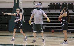 Assistant Coach Bill Baxter, center, tells Milee Enger (1), left, and Jazmin Carrasco (4) where to go for this play during the women's basketball team practice at The Nest at Sacramento State Tuesday, Oct. 27, 2020. The teams first game was scheduled for Monday, Nov. 30, 2020 was cancelled because of a possible coronavirus exposure.