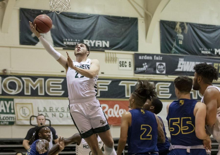 Bryce Fowler (23) makes a layup during the first half in the game against Bethesda University at The Nest at Sac State Wednesday, Nov. 25, 2020. Fowler is the leading scorer in the first half with 12 points.