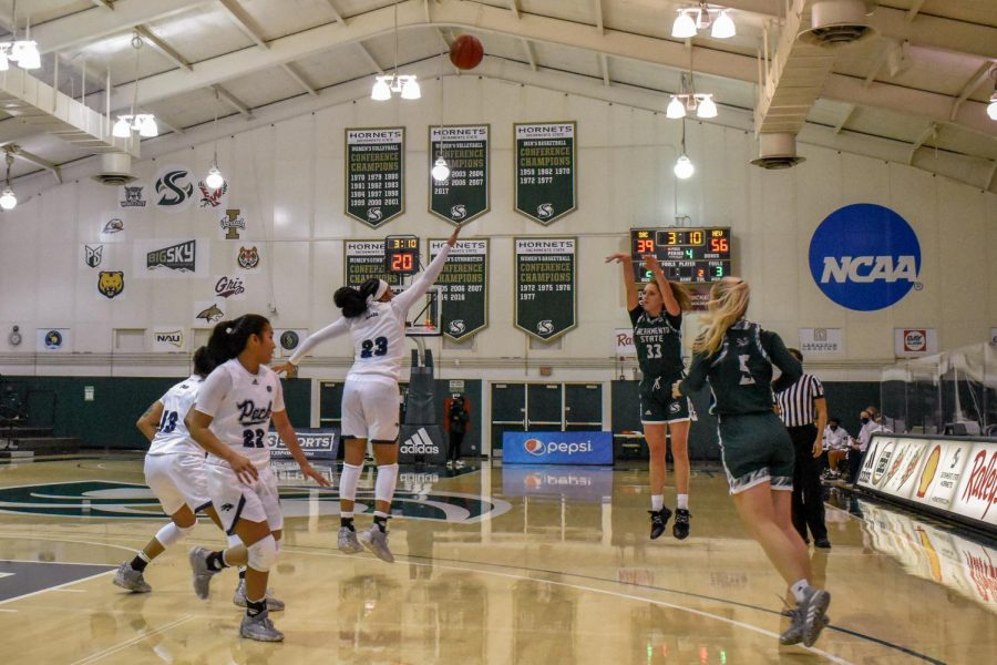 Sacramento State's Sarah Abney attempting a 3-pointer in the second half in the game against the University of Nevada at the Nest at Sac State Sun, Dec. 13, 2020. Sac State only had six players active for the game.