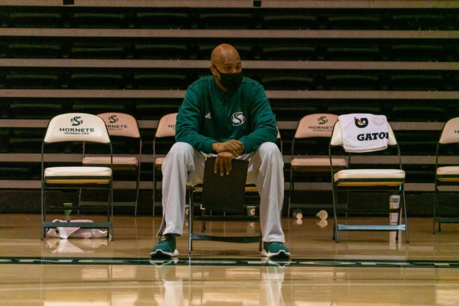 Derrick Florence, Assistant Coach for Sac State Women's Basketball, sits behind pensively after a 74 - 61 loss to Nevada Wolfpack. Despite being two players down by the second quarter, the team maintained an unrelenting effort during the December 12th game.