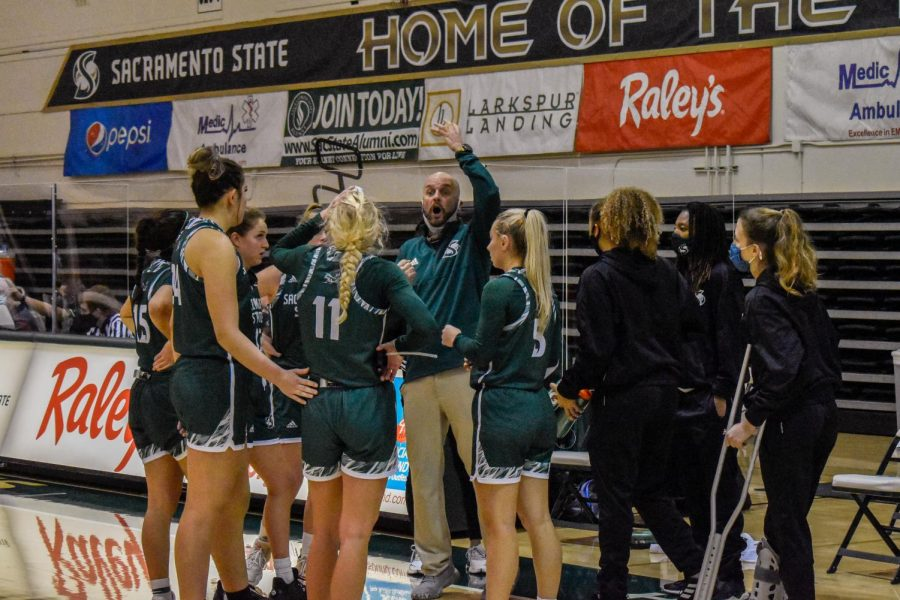 Coach Bunky Harkleroad discusses adjustments for the game to his players in the game against the University of Nevada at the Nest at Sac State Sunday, Dec. 13, 2020. Harkleroad said the team ultimately ran out of gas with only six available players.