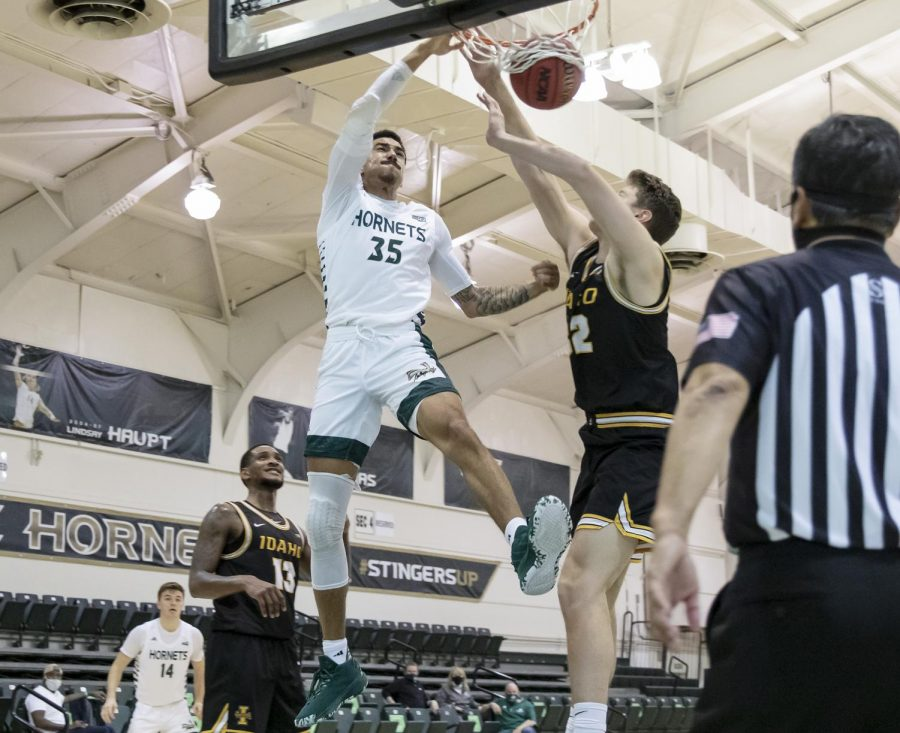 Sacramento State's Christian Terrell (35) drives to the basket with 10 seconds left on the shot clock and dunks the ball over Idaho's Tanner Christensen (32) during the second half in the conference opener in the game against the University of Idaho at The Nest at Sac State Thursday, Dec. 3, 2020. Terrell had 15 points in the game. Sac State won 77-55.