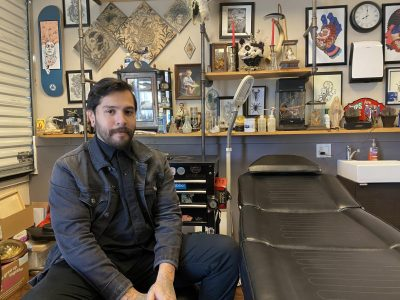 Osman De Los Santos, 27, in his private tattoo studio in Sacramento, Calif. on Dec. 7, 2020. In his free time, De Los Santos makes art commissions which he displays on the walls of his shop.