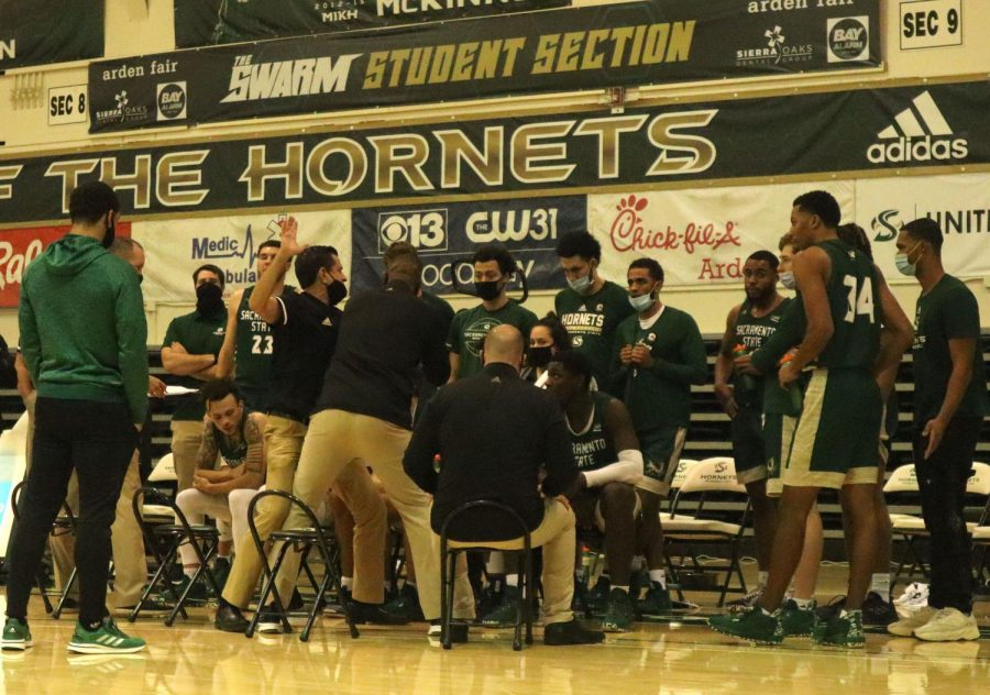 Sacramento State men's basketball head coach Brian Katz talks to the team during a timeout in the first half of a game against the University of Idaho at The Nest at Sac State Saturday, Dec. 5, 2020. The men's game scheduled for Dec. 12 against the Santa Clara University was postponed after concerns that a member of the Sac State travel party may have been exposed to the coronavirus.