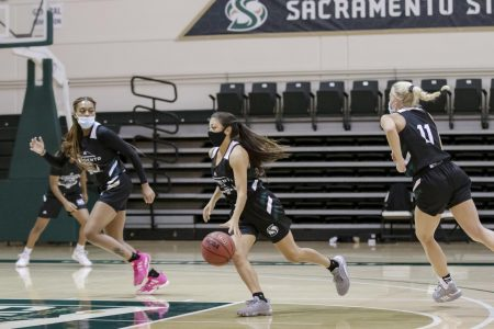 Jazmin Carrasco (4) dribbles the ball while she runs a play during the women's basketball team practice at The Nest at Sacramento State Tuesday, Oct. 27, 2020. The matchup against UC Davis Tuesday, Dec. 8, 2020 has been canceled due to an update to the Yolo County health order.