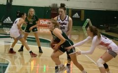 Junior guard Emily Enochs (#12) looks for a push to the basket during Sac State's game against Eastern Washington Saturday, Jan. 30, 2021 at the Nest. The Hornets fell to 1-12 on the season after winning their first game against the Eagles on Thursday.
