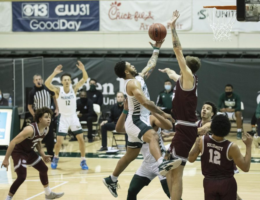 Sacramento State Hornets guard Brandon Davis (11) makes the layup over Montana Grizzlies forward Mack Anderson (23) during the second half during the conference game at the Nest at Sac State Thursday, Jan. 21, 2021. Davis had 11 points in the game.