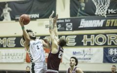 Sacramento State Hornets forward Ethan Esposito (22) draws the foul from Montana Grizzlies forward Mack Anderson (23) during the second half of the conference game at the Nest at Sac State Thursday, Jan. 21, 2021. Esposito made both free throws.