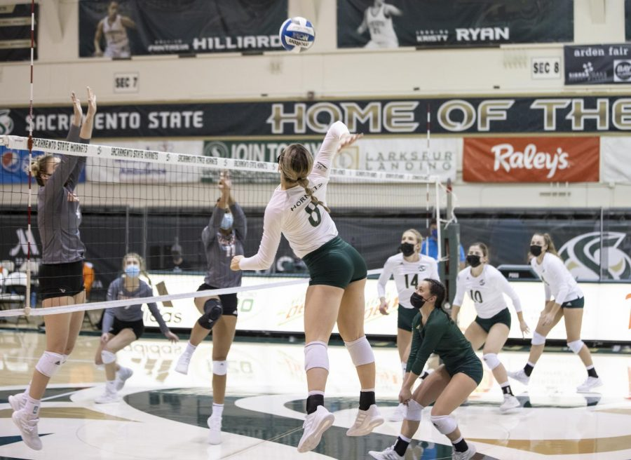 Sacramento State freshman outside hitter Bridgette Smith (8) spikes the ball to score in the first set of the conference match against Idaho State at the Nest at Sac State on Sunday, Jan. 31, 2021. Smith had a double-double with 13 assists and 10 digs. Sac State won 3-0.