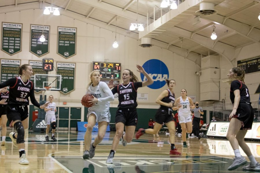 Summer Menke (11) defends the ball from EWU Womens Basketball player Maisie Burnham (15), Grace Kirscher (37) and Jenna Dick (5) during the conference game against Eastern Washington University at the Nest at Sac State Thursday, Jan. 28, 2021. Menke is a third year at Sac State.