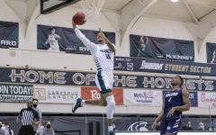 Sacramento State's Christian Terrell (35) makes a fastbreak layup past Fresno Pacific's Aamondae Coleman (4) during the first half of the home game Sunday, Jan. 3, 2021. Terrell had 20 points in the first half and 26 points total.